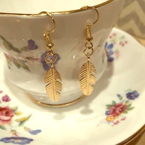 Gold tone feather earrings. NWOT